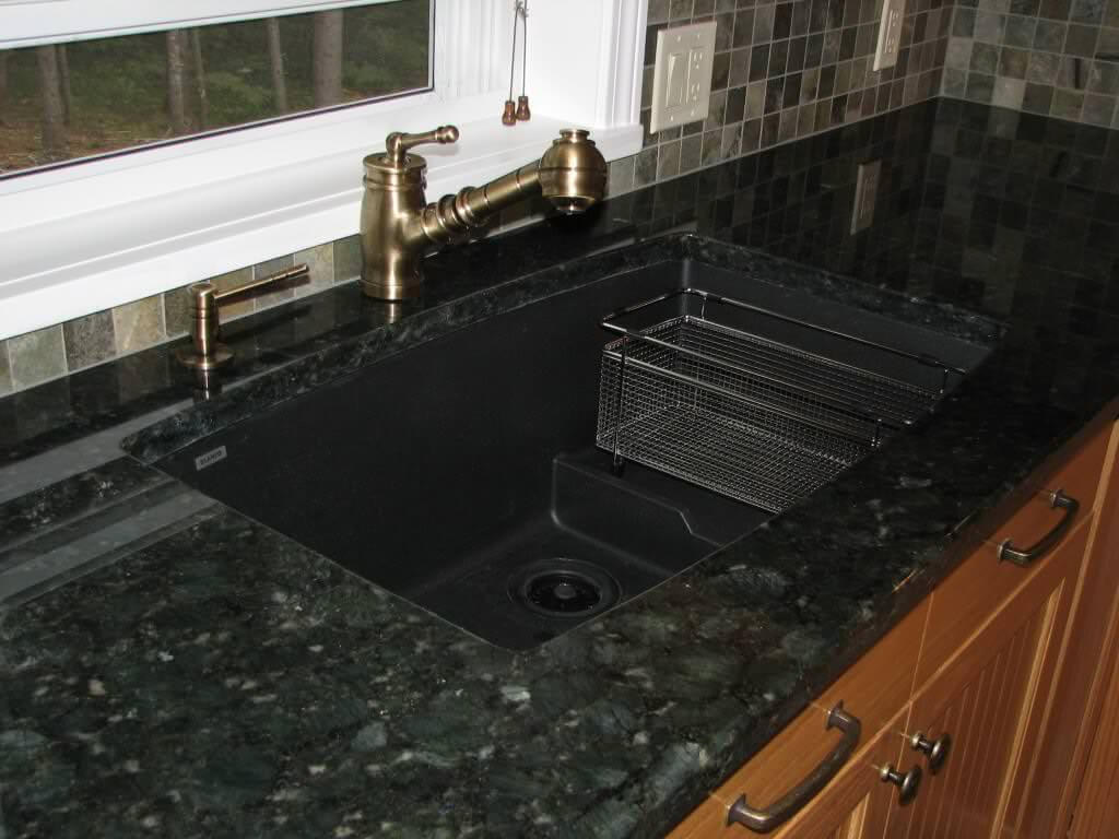 Verde butterfly granite countertops pictures pricing for Silgranit countertops