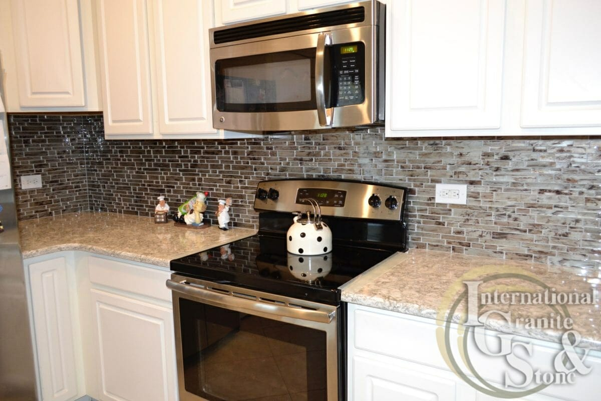 International Granite And Stone Cambria Berwyn White Cabinets White  Countertops Stainless Steel Appliances