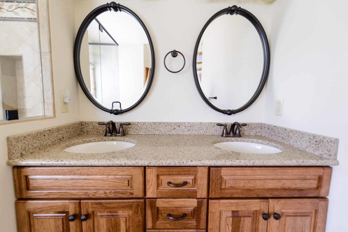 granite bathroom double vanity with 4 inch backsplash