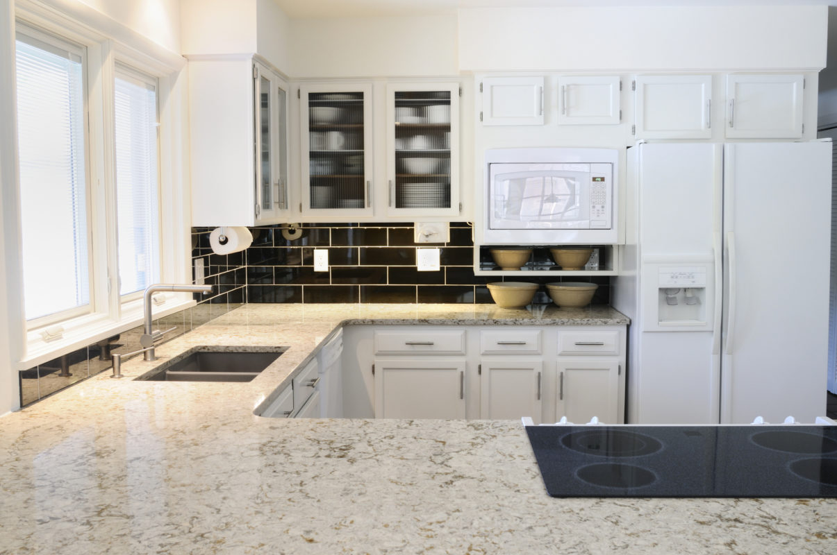 custom granite countertops white ktichen black subway tile backsplash