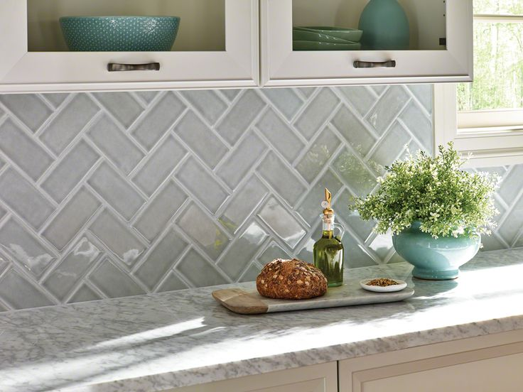 herringbone backsplash tile granite white quartz quartzite marble countertops white cabinets