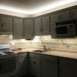 under cabinetry lighting tile backsplash gray cabinets