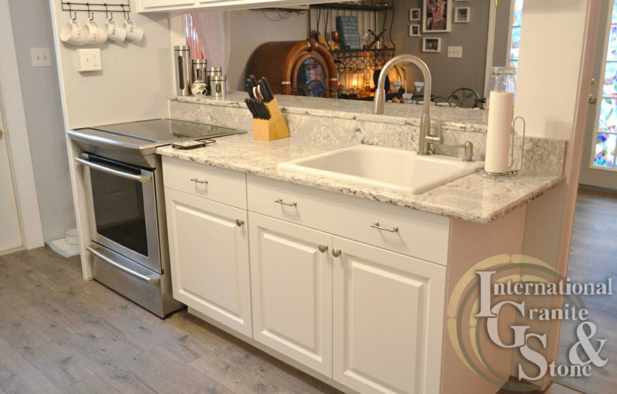 Summerhill Cambria Quartz white countertops white cabinets stainless steel appliances highbar