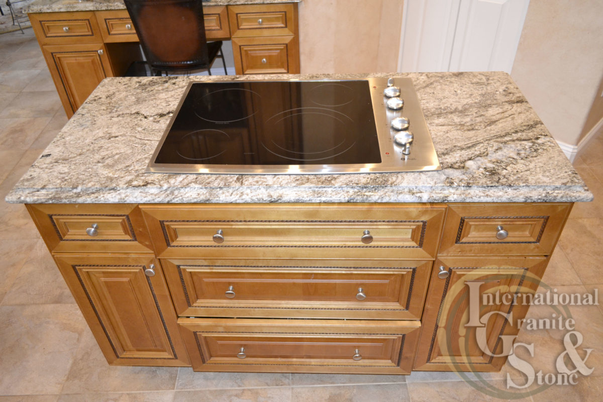 typhoon taupe granite countertops kitchen cooktop island ogee edge